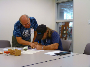 VE Mike Conte W4NYY assisting an amateur radio testing candidate.